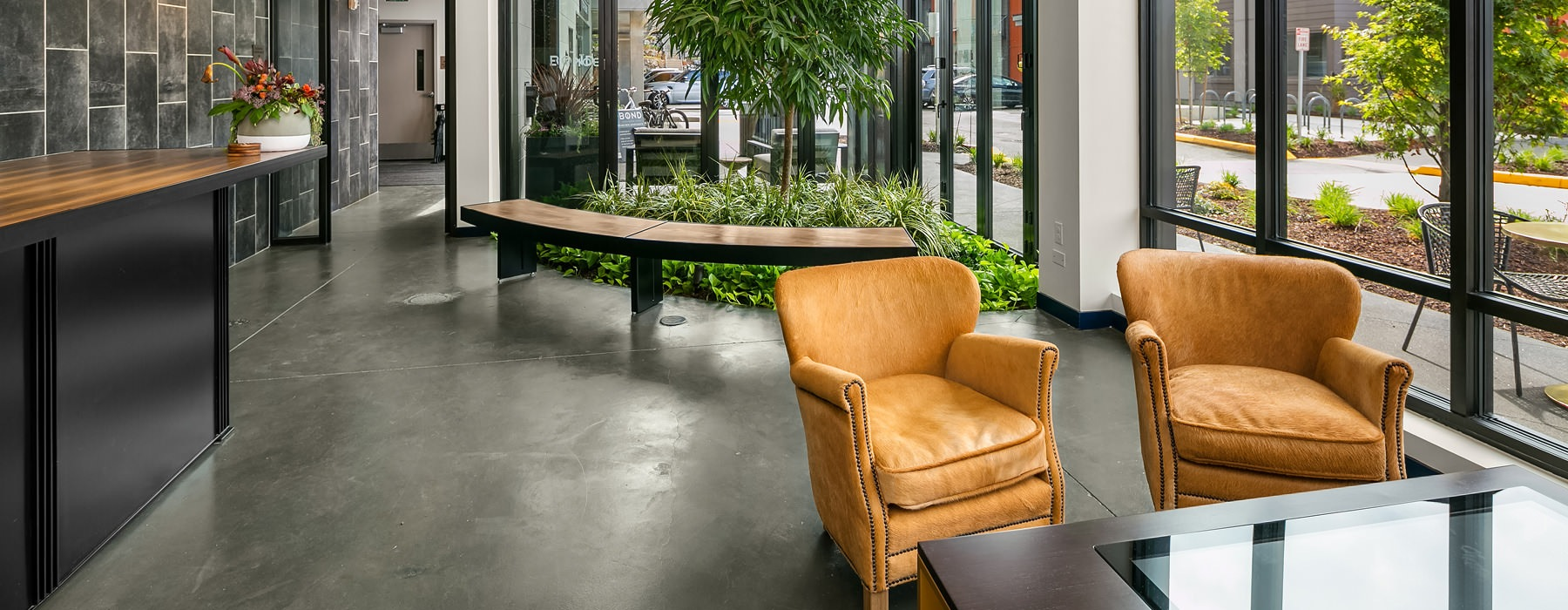 floor-to-ceiling windows and seating areas provided in apartment lobby
